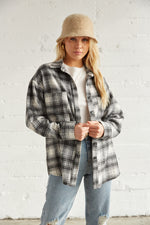 Black and white flannel shacket.