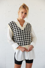 Black and white houndstooth vest.