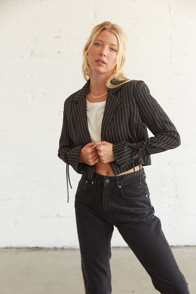 Cropped blazer with lace up tie detail on sleeves.