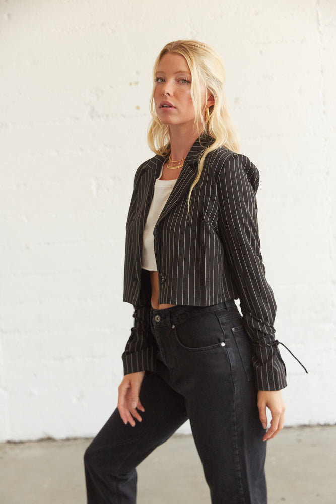 This side of this crop blazer jacket has tie detials.