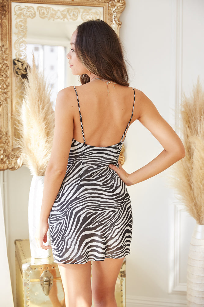 The back of this mini dress is relaxed with adjustable spaghetti straps.