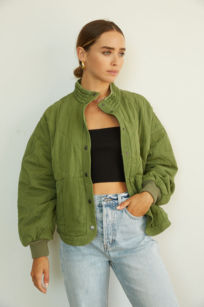 Green oversized quilted jacket.