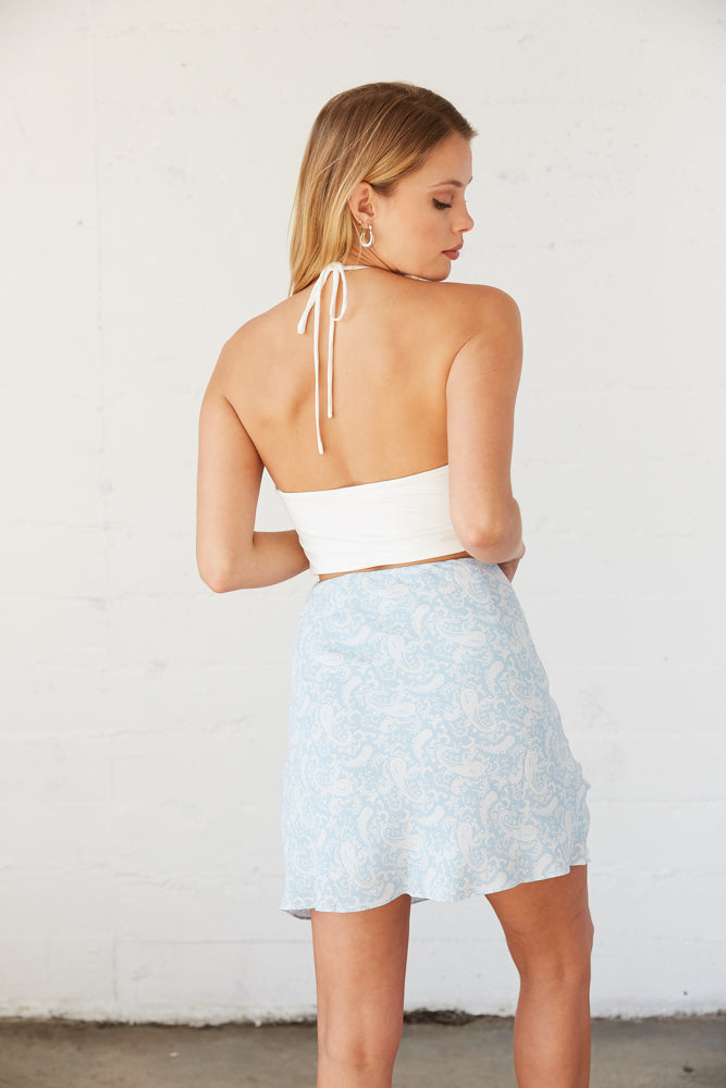 Back view of printed mini skirt.