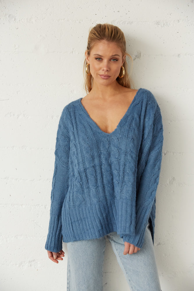 Blue oversized knit sweater.