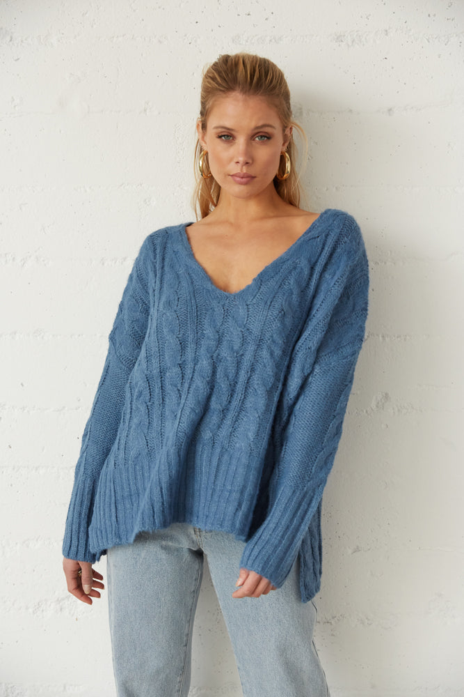 This sweater has a relaxed oversized body.