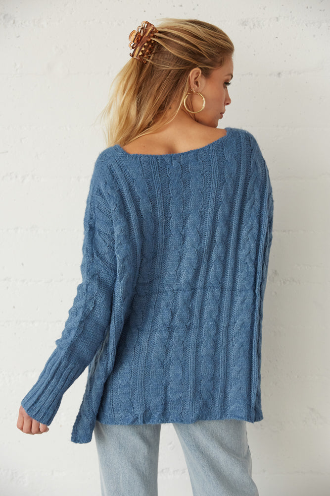 The back of this sweater is oversized.