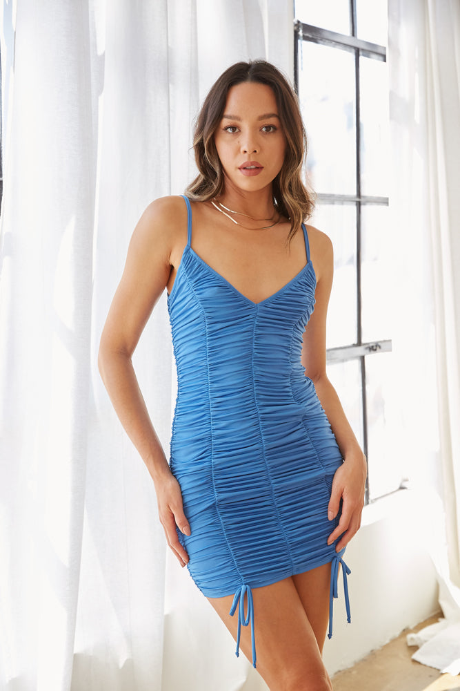 Blue ruched mini dress.