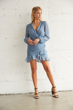 Ruffle mini dress with long sheer sleeves.