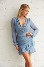 Blue ruched wrap dress with longe sleeves.