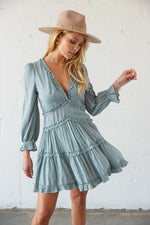 This dress has long sleeves with elastic ruffle sleeves.