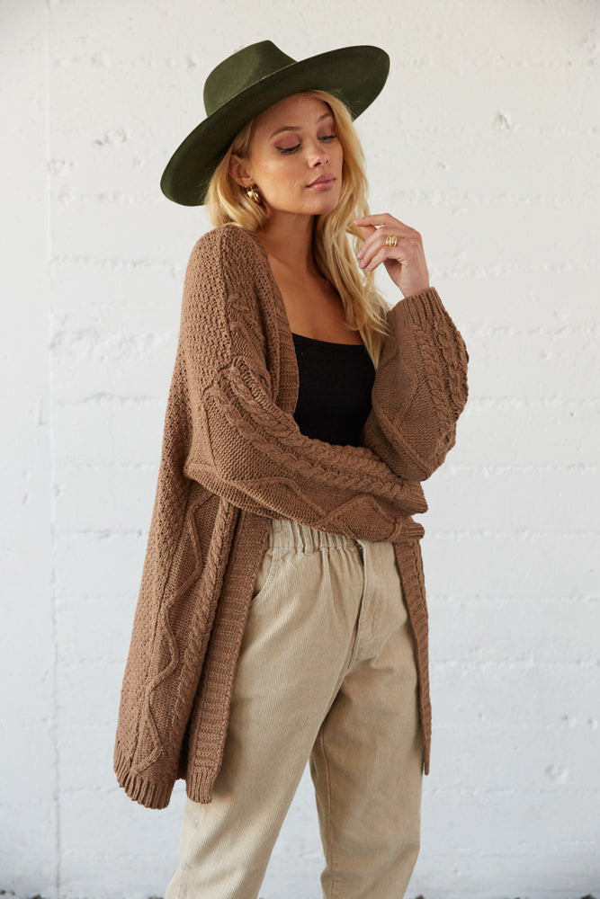 Oversized brown cardigan with knit design.