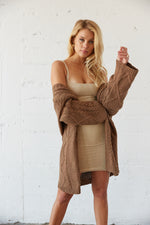 This slouchy oversized sweater has an open front and long sleeves.