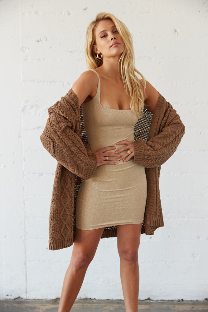 Brown chunky knit cardigan.
