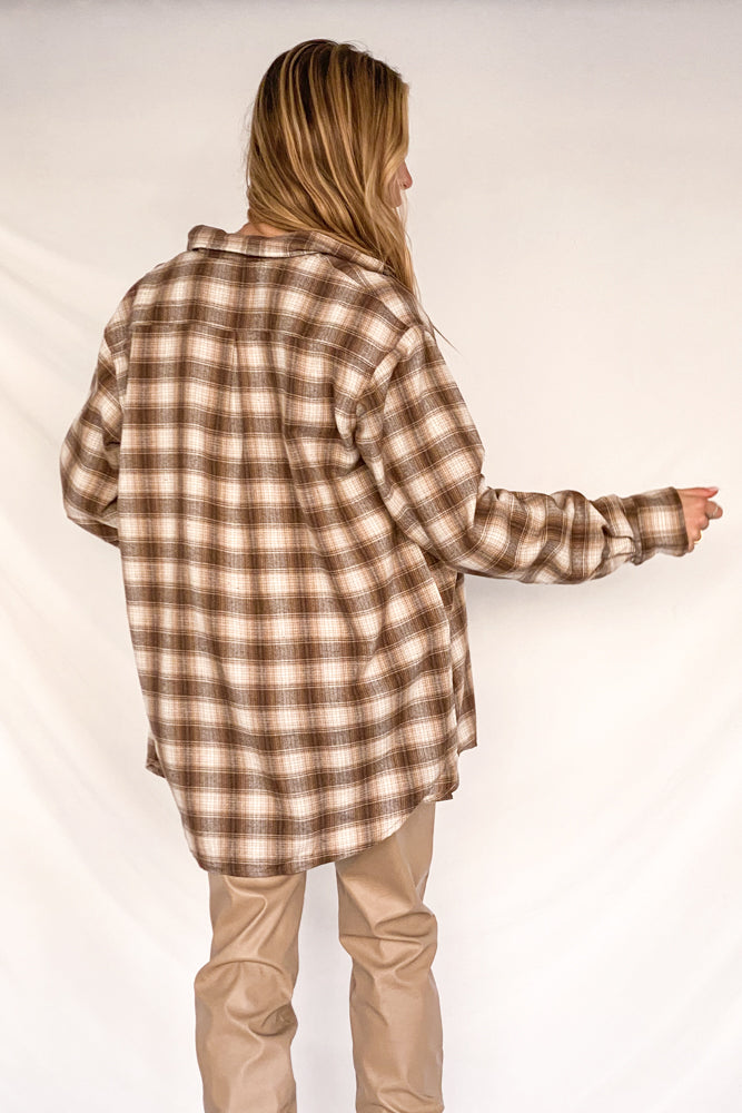 The back of this shirt has a brown plaid design.