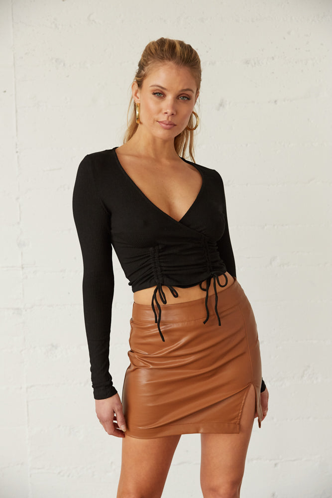 Tan vegan leather skirt.