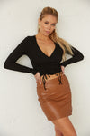 High waisted mini skirt in vegan leather.