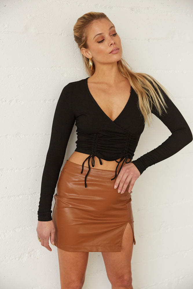 This mini skirt is complete with a side slit detail.