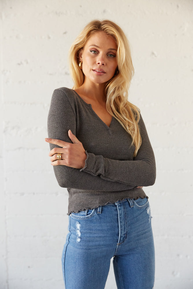 Grey ribbed crop top with ruffle lettuce hem.