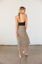 The back of the skirt is relaxed with a flowy silhouette.