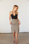 Leopard print midi skirt with black tank top.