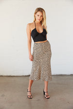 Flowy midi skirt with black and nude animal print.