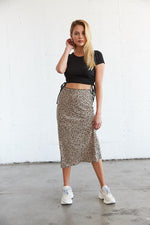 Style this midi skirt with a black crop top for a casual look.