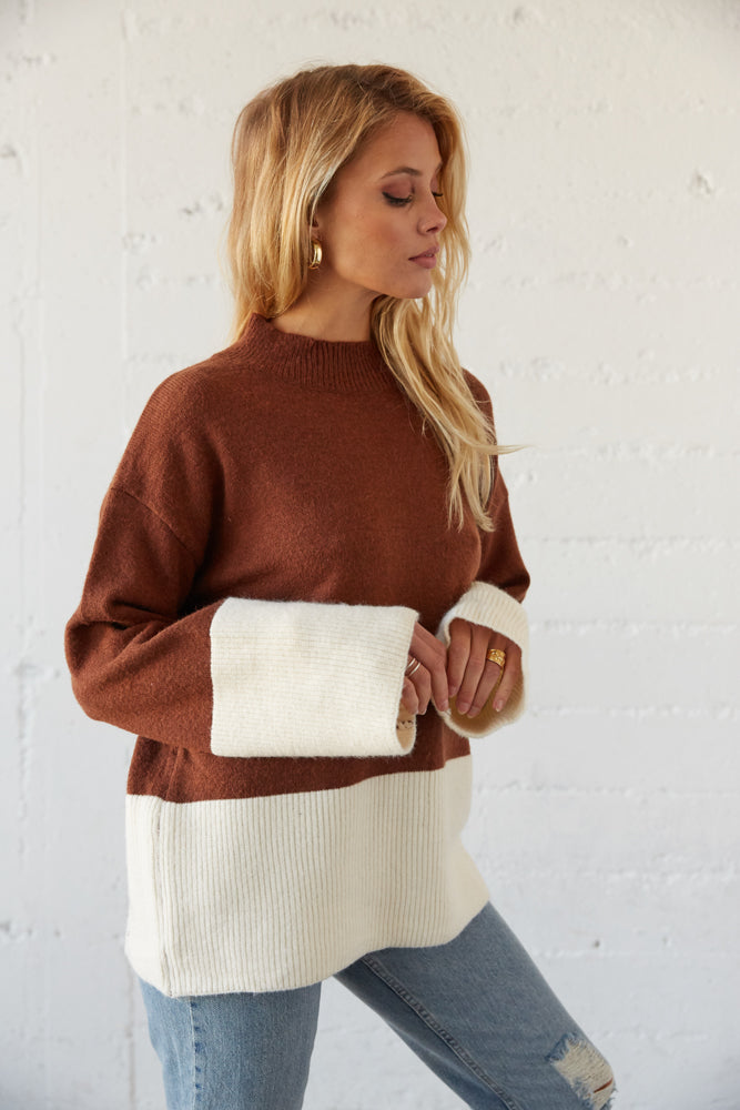Ribbed detailing on the sleeves.