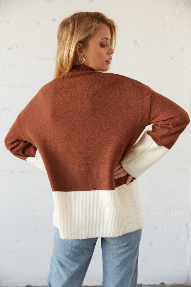 The back of this sweater is relaxed with the brown and white colorblock design.