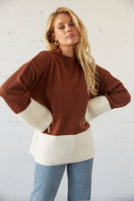 Brown and white colorblock sweater.