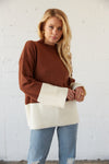 Oversized ribbed knit sweater with colorblock design.