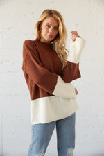 Brown and white colorblock sweater with mock neckline.