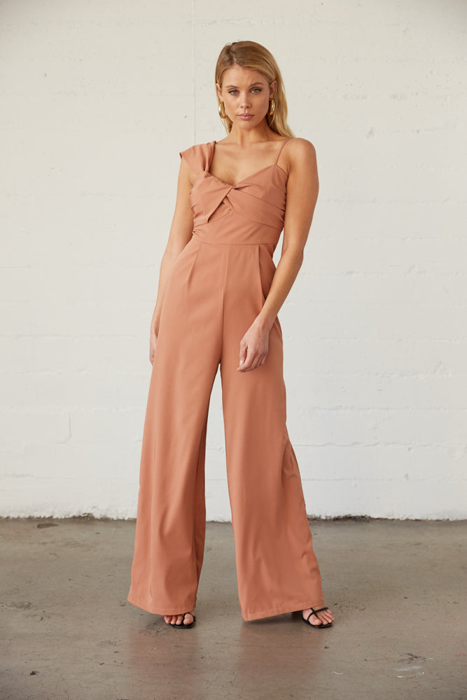 Pantsuit with twisted bust and asymmetrical straps.