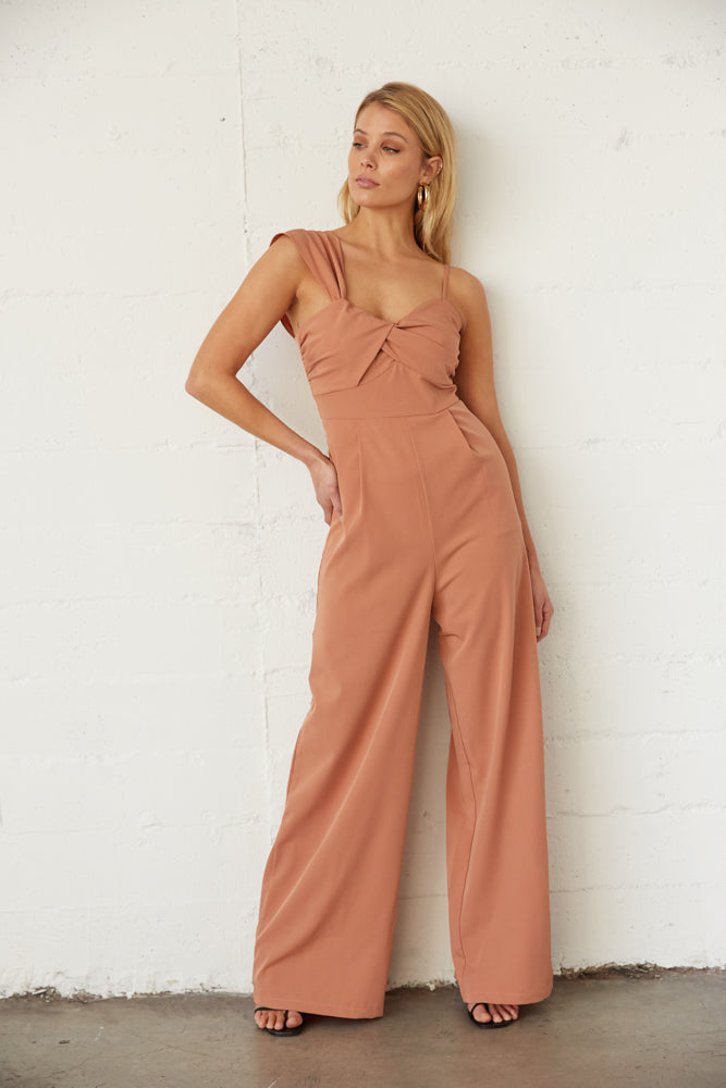 The gorgeous jumpsuit has pleated legs and side pockets.