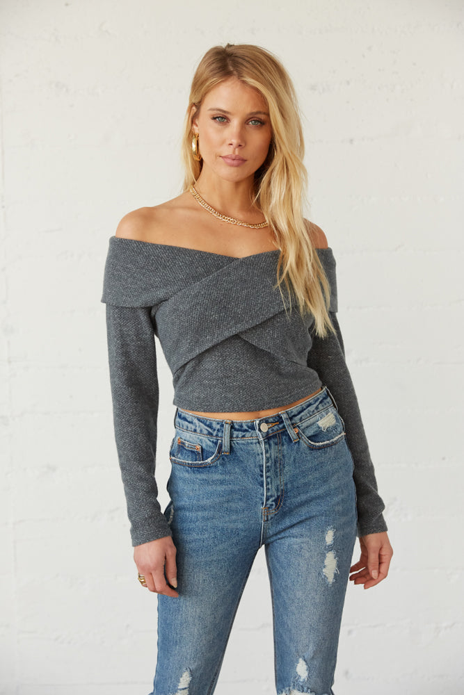 Criss cross knit sweater.