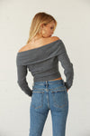 The back of this sweater has a cropped fit and a top overlay.
