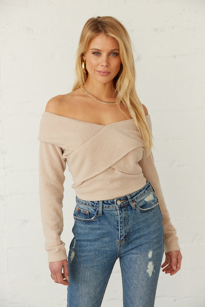 Natural criss cross off shoulder sweater.