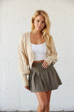 High waisted tennis skirt with cropped cardigan.