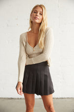 Black pleated tennis skirt with cardigan set.