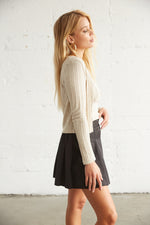 The side of this tennis skirt has pleated detailing.