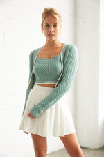Green crop sweater set with matching crop tank.
