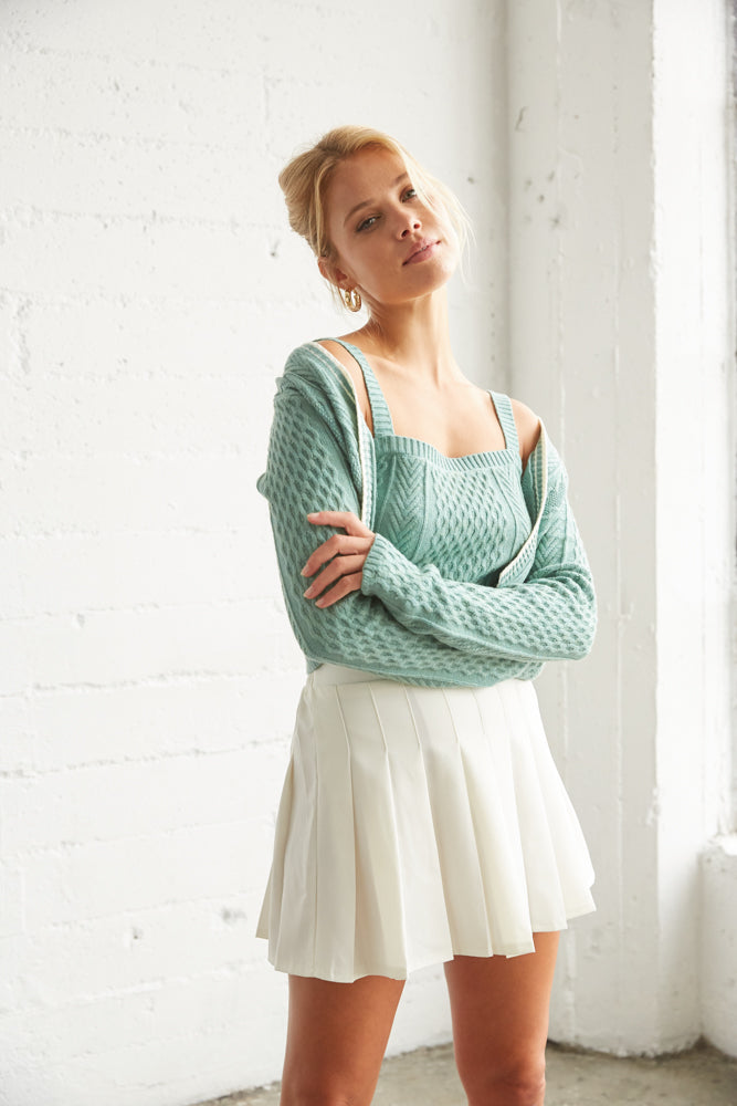 Green crop tank with matching crop cardigan.
