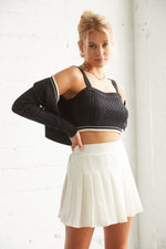 White pleated tennis skirt with high rise silhouette.