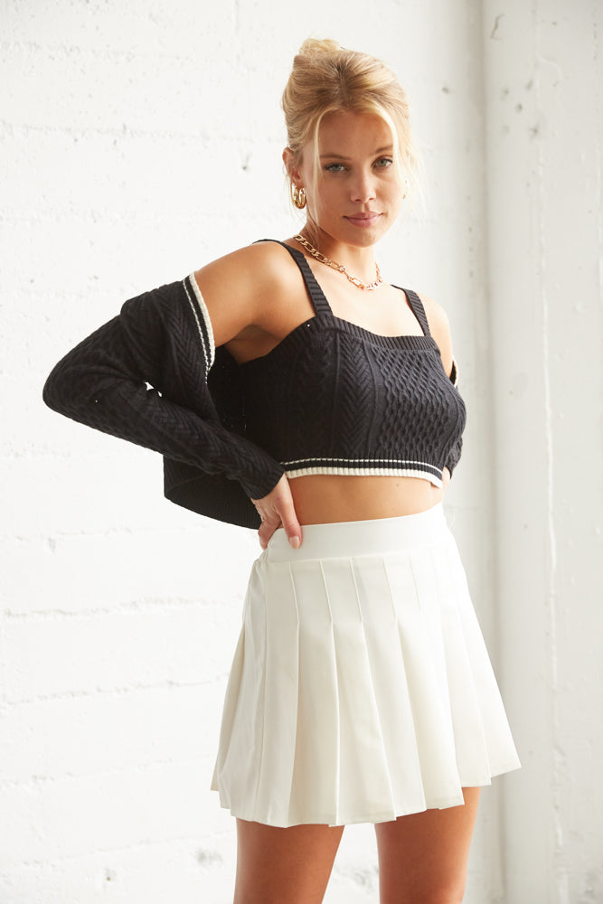Crop sweater with white striped trim.