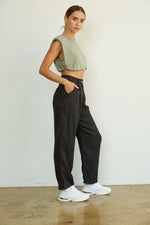 The side of these trousers show off the side pockets and relaxed fit.