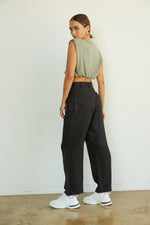 The back of these pants have a relaxed fit and a mock slit pockets.