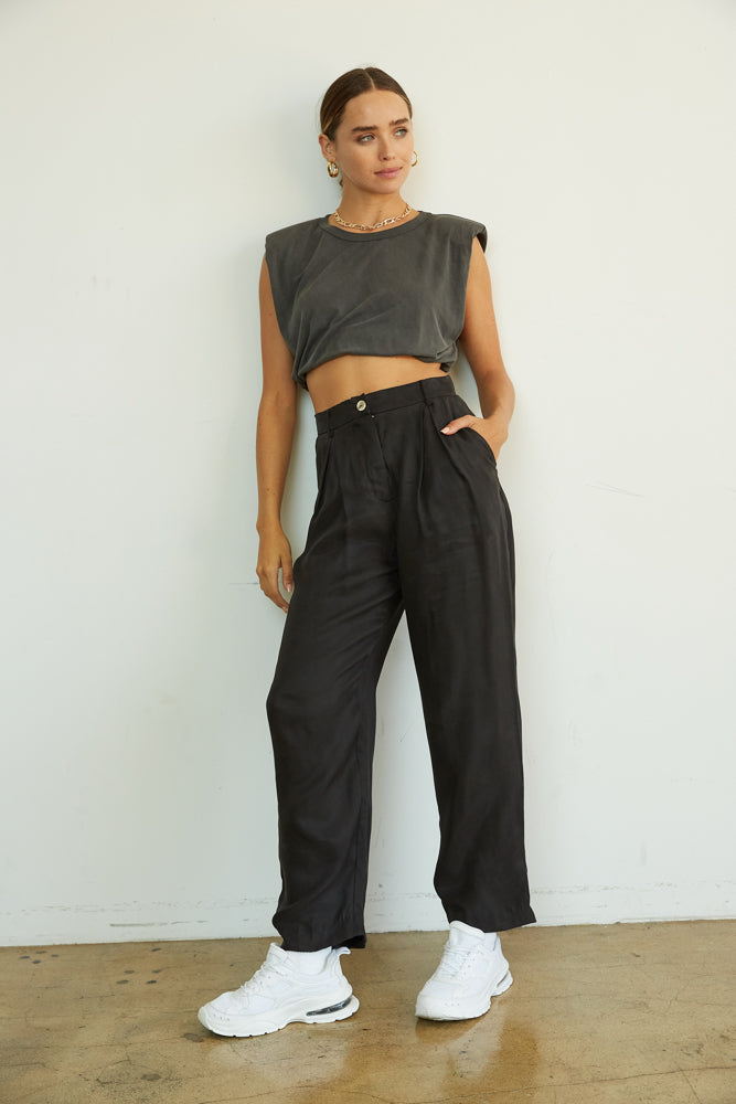 Black high waisted pants with grey crop top.