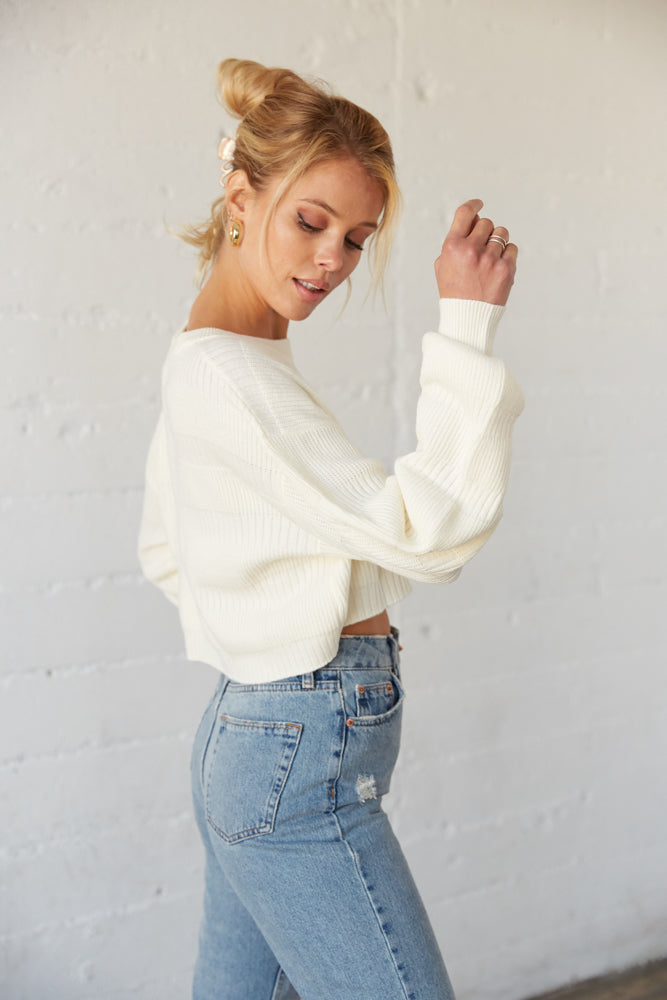 The side of this sweater shows off the slouchy sleeves and ribbed armholes.