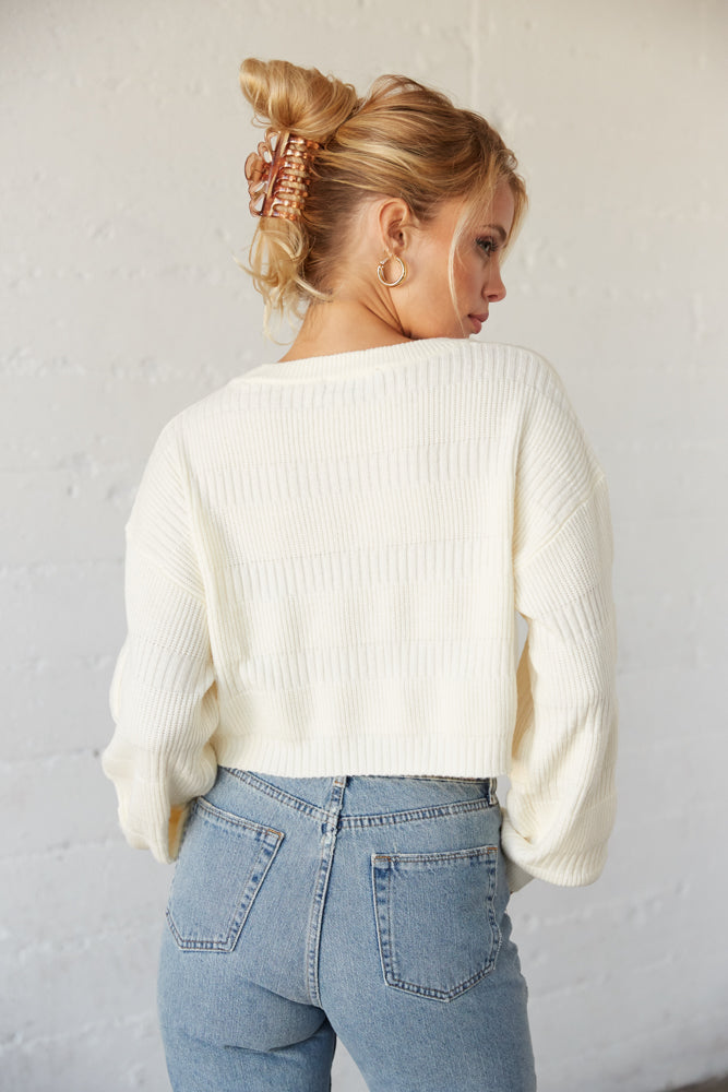 The back of this sweater is cropped and ribbed.