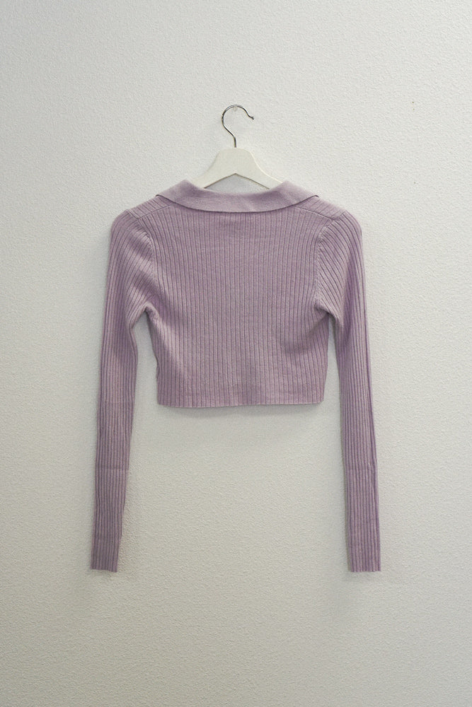 The back of this sweater is ribbed and cropped.