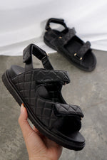 Zora Quilted Sandal In Black